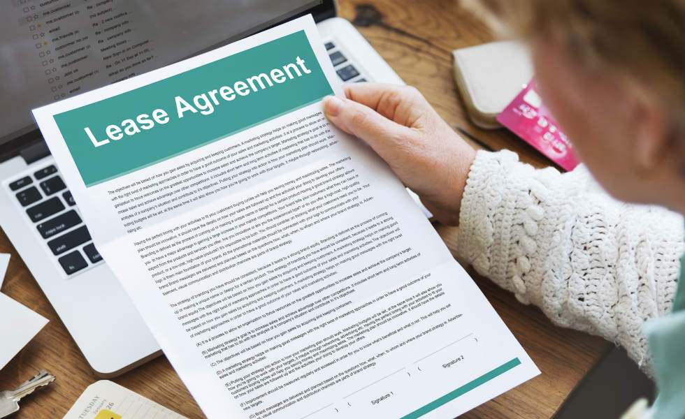 landlord-holding-renter's-agreement